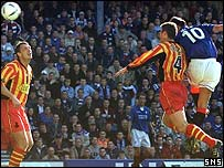 Michael Mols rises to head home the opening goal