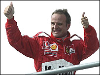 Rubens Barrichello waves to the home fans after setting pole position in Brazil