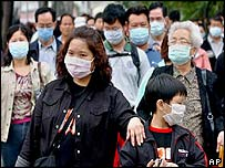 Hong Kong residents wearing masks