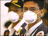 Malaysian health officials in masks at Kuala Lumpur airport