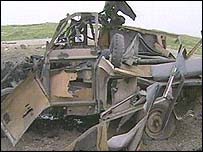 Wrecked vehicle after apparent US air attack on coalition forces