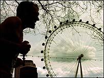 A runner passes the London Eye