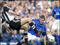 Jonathan Woodgate (left) and Wayne Rooney compete for the ball
