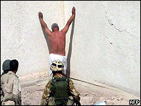 Marines check a man who surrendered as a suicide bomber