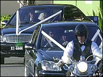 Bride Danielle Spencer (rear car) was driven in a motorcade
