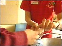 A nurse sets a child's finger in plaster