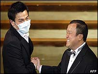 Andrew Lau (left) with Eric Tsang