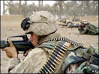US Marines of the 3rd Battalion, 4th Regiment take positions as they secure a key bridge leading into Baghdad