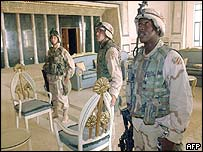 US soldiers in palace reception room
