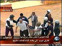 Al-Jazeera colleagues carry a casualty to a nearby car