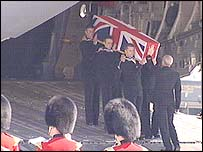 Coffin draped in Union flag is carried off the plane