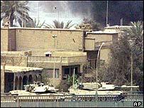 US tanks advance east over the Republic (or Jumhuriya) Bridge across the River Tigris