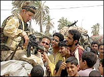 British soldier and Iraqi civilians