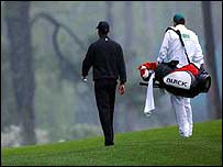 Tiger Woods and caddie at Augusta on Tuesday