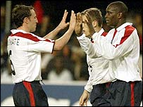 Emile Heskey is congratulated by fellow goalscorer Gareth Southgate