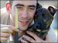 Jake the Staffordshire Bull Terrier puppy with owner John Mallett and the knife