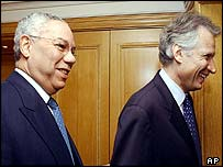 Colin Powell and Dominique de Villepin arrive for meeting