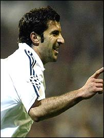Luis Figo celebrates scoring the opening goal for Real Madrid against Man Utd.