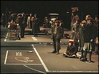 Moses (bottom left) in Dogville