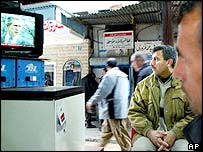 A man watches television on a Kirkuk street