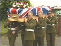 Private Kelly's coffin is carried into the church