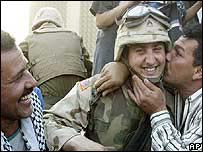 Iraqi men kiss US serviceman