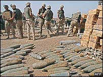 US soldiers put a weapon stash left by the defeated Iraqi Army in the grounds of a police station in Baghdad