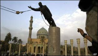 The statue of Saddam being pulled down by US marines