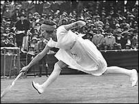Suzanne Lenglen stretches for the ball at Wimbledon