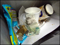 Photo of sterling and euros in a rubbish bin