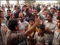 Basra men cheering in the streets after hearing news from Baghdad
