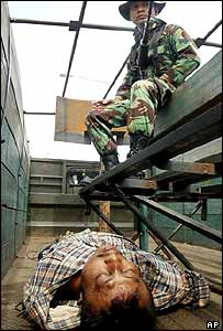An unconscious Tengku Hasan Muda being taken to a military hospital by Indonesian troops