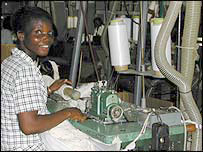 Lady sewing socks in Tema