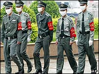 Masked security guards at Beijing railway station