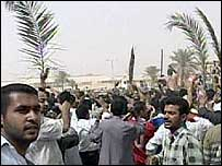 People holding palm fronds in Baghdad