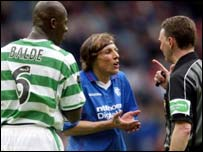 Bobo Balde and Claudio Cannigia debate with referee Hugh Dallas