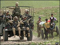 American special forces pass Iraqi Kurds in northern Iraq