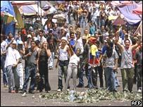 Chavez supporter jeers opposition demonstrators