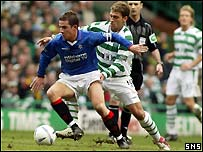 Barry Ferguson holds off Celtic's Stilian Petrov