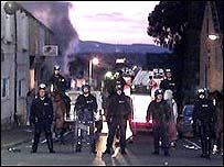 Police form a line during the Burnley riots in June 2001