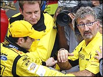 Giancarlo Fisichella (left) and Eddie Jordan (right) look dismayed as they are told they have not win the Brazilian Grand Prix