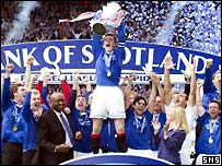 Barry Ferguson holds the SPL trophy aloft