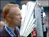 Rangers manager Alex McLeish kisses the Scottish Premier League trophy after his side claimed the title after a 6-1 win against Dunfermline