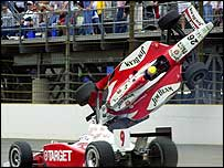 Dan Wheldon's car goes airborne after hitting the wall on the third turn