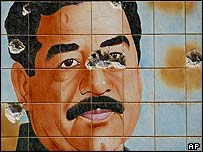 Mosaic of Saddam Hussein defaced by gunfire