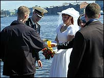 Newly weds drinking toast by the Neva river