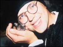 Naturalist Howie Watkins (r) with a rat