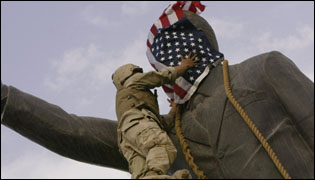 American flag draped over Saddam statue