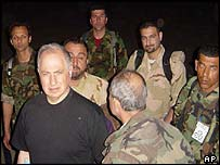 Ahmad Chalabi (left) arrives in Nasiriya on Sunday 6 April 2003