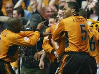 Wolves' goalscorer Mark Kennedy is mobbed by his team-mates